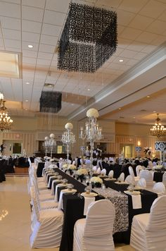 Black and white table setting  with crystal candelabras