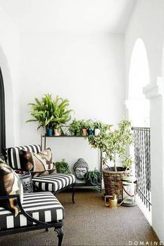 urban garden ideas black and white chairs on a balcony