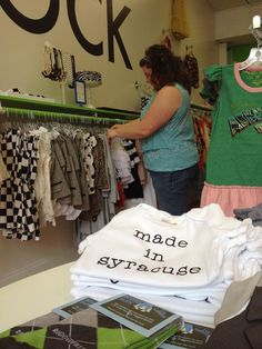 """Made in Syracuse onesie.  Visit Indie Kids in Armory Square for hip children's clothes and to """"build a cape""""."""