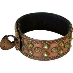 Dates early 1800's and was purchased in Aire-sur-la-Lys, France. The beautiful collar features brass studs, flowers, and dog faces.  The condition is