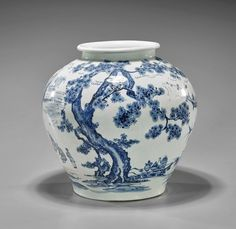 """Korean Blue & White Porcelain Vase of baluster form with everted rim, a group of seated scholars sitting in a continuous pine and mountain landscape; H: 9 1/2"""""""