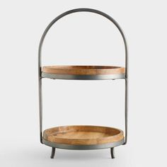 SHOP NOW: Wood And Metal Serving Stand. Our Wood and Metal Serving Stand presents food and decor with casual style. Natural mango wood tiers add a rustic look, metal feet provide stability and a large handle makes it very easy to transport.