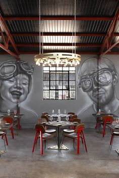 Completed in 2016 in Johannesburg, South Africa. Images by Micky Hoyle. Haldane Martin Iconic Design has designed a brewery and restaurant interior for Mad Giant beer that plays with scale referencing oversized metal toy. Brewery Restaurant, Red Restaurant, Beer Brewery, Restaurant Design, Restaurant Ideas, Restaurant Interiors, Brewery Interior, Cafe Interior, Pop Art