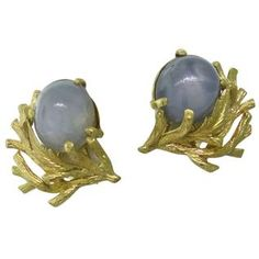 Naturalistic Star Sapphire Cabochon Gold Earrings Available @ hamptonauction.com at the Fine Jewelry Watches Coins and Collectibles Auction on January 26, 2015! Come preview our catalog!
