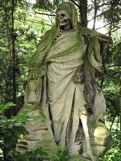 The Grim Reaper sculpture by August Schmiemann (sculptor) on the Melaten cemetery in Cologne and sponsorship grave