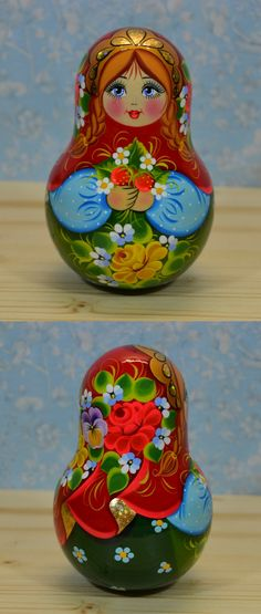 hand painted roly-poly doll with strawberry, by artist Nadezhda Tihonovich