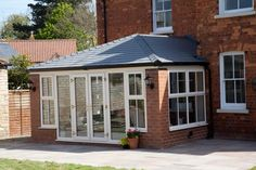Solid roof sunrooms from Wessex Windows in Winchester come in various styles, colours and finishes. Get your free quote today! Tiled Conservatory Roof, Orangery Roof, Conservatory Dining Room, Conservatory Ideas, House Extension Design, Roof Extension, Extension Ideas, Glass Extension, Garden Room Extensions
