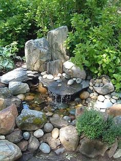 Stunning Relaxing Garden And Backyard Waterfalls with Nature feel: Small Beautiful Pond With Huge Tall Moss Covered Boulders And Small Rocks Accents To Create Outdoor Natural Feel Water Fall ~ http://usedboatsfloat.com Decorating Inspiration