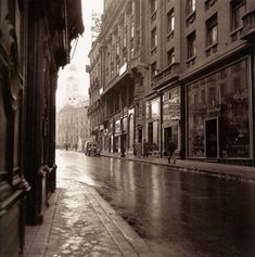 Calle del Arenal on a rainy day. At the back, the clock of Puerta del Sol, Madrid, Spain Madrid City, Foto Madrid, Barcelona City, Old Photography, Street Photography, Best Hotels In Madrid, Madrid Travel, World Cities, Majorca