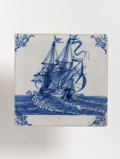 17th cen Tile, tin-glazed earthenware, one of a set of tiles showing ships (C.566:1 to 16-1923), used as a panel in a fireplace or on a wall. Painted in blue on a white tile. V C.566:6-1923