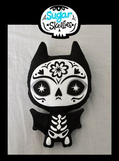 http://www.etsy.com/listing/77440180/sugar-skull-toy-day-of-the-dead-toy-dia?ref=sr_gallery_37_search_submit=_search_query=day+of+the+dead_view_type=gallery_ship_to=GB_search_type=handmade_facet=handmade