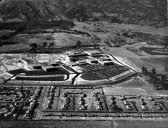 (1959)^^ - Aerial view of the West San Fernando Valley (now West Hills).  View is looking west toward the Ramo Woolridge facility with a portion of the Chatsworth Reservoir seen in the upper right.  The main street running horizontally from left to right and then slightly curving up is Fallbrook Ave. The street at lower left running up from bottom is Eccles Street.