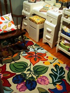 Take one of those foam play mats and paint it! Much prettier and soft on feet. Such a great way to re-use.