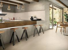Modern kitchen diner with open bar area and bi-fold doors leading to courtyard. Bar Areas, Home Interior Design, Tiles, Flooring, Kitchen, Furniture, Home Decor, Doors, Houses
