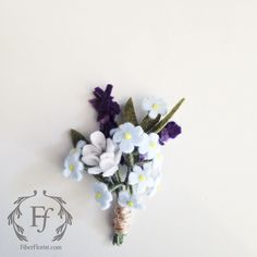 Fiber Florist felt wedding boutonniere. Featuring forget me nots, mascara and lavender flowers. Custom order made of wool felt, wire and beads.