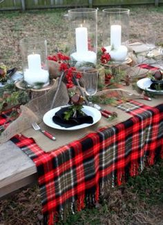 "Notice the burlap placemats on TOP of the plaid throw and also the burlap ribbon and log ""rounds"" used as pedestals.  Charming!"
