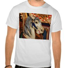 Gray Maned Carousel Horse T-shirt - $23.95 - Gray Maned Carousel Horse T-shirt - by RGebbiePhoto @ zazzle - A white carousel horse with a gray mane and blue halter. Close up on the face area, with lights in the background.