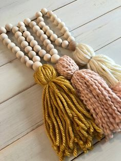 Items similar to Mustard Boho Wood Bead Tassel on Etsy Wood Bead Garland, Beaded Garland, Garlands, Yarn Crafts, Bead Crafts, Arts And Crafts, Diy Tassel, Tassels, Wall Collage Decor