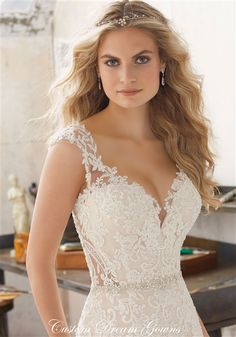 Dreamy Wedding Dress! 2017 Elegant Beaded Alencon Lace on Tulle Over Satin A-Line Gown with an Illusion Lace V-Neckline Over Deep Sweetheart Interior, Beaded Illusion Lace Tank Straps, Crystal Beaded Lace Fitted Bodice to Hips with Crystal Beading Along Natural Waistline, Beaded Lace Applique into A-Line Tulle Skirt, Chapel Train, Beaded Illusion Lace Keyhole Back with Covered Buttons. #keyholeback #illusionlaceweddingdresses #bridalgown #romantic #dreamweddingdress #wedding #bride…