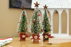 LOVE these little Christmas trees on wooden spools.