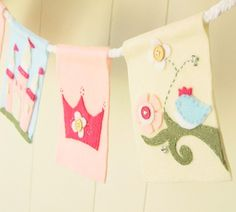 cut out silhouettes of a castle and crown to make a felt party banner---use rope & glue to attach