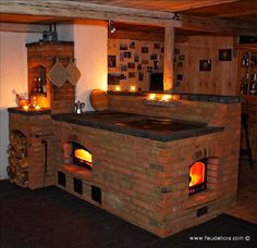 Brick masonry heater and cookstove in France by feudebois.com. Clay brick and ceramic tiles are best at taking thermal stress.