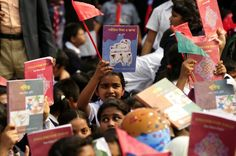 """Students celebrating the """"Textbook Festival Day"""" in the capital's Government Laboratory School."""