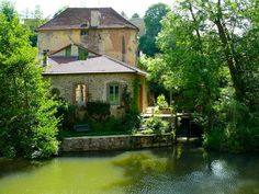 Semur - Old mill house on River Armançon    by © Claude Shoshany