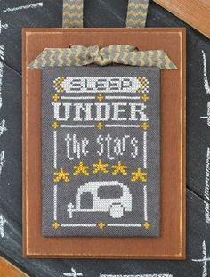 "August Year In Chalk Sleep Under The Stars is the title of this cross stitch pattern from Hands On Design ""A Year In Chalk Series"" and is for the month of August. The cross stitch pattern is stitched with Gentle Art Sampler threads Chalk and Sunflower. Click on highlighted links to add the fibers and fabric to your shopping cart."