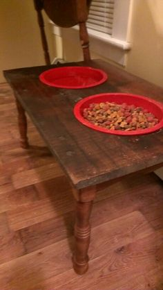 Raised dog bowl made from old end table amd topped with reclaimed barn wood.