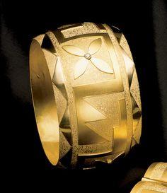 Tammy Garcia - Blue Rain Gallery / Santa Fe New Mexico...Native American gold bracelet