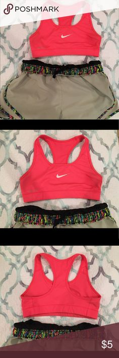 Pink NIKE Dri-Fit Sports Bra Hot pink/coral sports bra. I have only worn this once or twice to the gym about 5 years ago and it has been sitting in my closet ever since. There are some ink stains that will fade in the wash (I wash and dry all garments before shipping!) but the price reflects the stain. This is a great sports bra if you are smaller chested. Nike Intimates & Sleepwear Bras