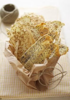 sheets of bread with sesame and poppy seeds  I like the one with dried sage and pink salt
