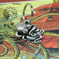 Octopus Keychain - Handmade Artisan Pewter - Octopus Squid Tentacle Zipper Pull - Cthulhu Inspired Steampunk Cephalopod Swag by Doctorgus Squid Tentacles, Octopus Squid, Octopus Jewelry, Spoon Jewelry, Little Octopus, Cthulhu, Pewter, The Help, Steampunk