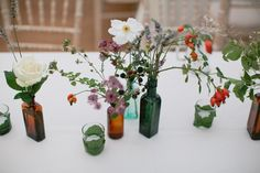 Wild flower table display using rosehips, ripening blackberries and lavender | Photography by http://rosieanderson.co.uk/