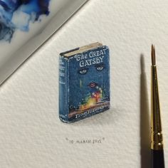 "Lorraine Loots, an expert at creating tiny art ""for ants,"" is back with a new series of mind-bogglingly small (and beautiful) paintings of animals, space, and her favorite books."