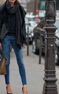 Skinny jeans, a pair of black high heels and wrap round black coat. All you need.