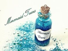 Amazing tutorial for a cute bottle charm!  MATERIALS:  1. Miniature Bottle 2. Clear glue 3. Blue food coloring 4. Micromarbles 5.Glitter 6.Toothpick 7. Eye pin