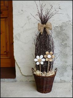 This is a neat idea but I would put real flowers (either yellow or purple for Easter) in the base instead of those neutral o… Deco Floral, Arte Floral, Wood Crafts, Diy And Crafts, Nature Decor, Real Flowers, Spring Crafts, Easter Crafts, Flower Pots