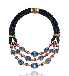 A SAPPHIRE RUBY AND DIAMOND NECKLACE BY BULGARI Designed as three rows of spectacle-set cabochon sapphires linked by ruby bead and diamond-set rondelle spacers to the double dark blue silk cord and gold clasp cm Signed and with maker's mark for Bulgari High Jewelry, Jewelry Art, Beaded Jewelry, Jewelry Necklaces, Fashion Jewelry, Jewelry Design, Beaded Necklace, Gold Necklace, Ruby And Diamond Necklace