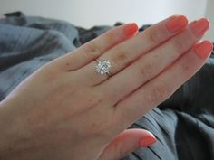 2 carat oval forever brillliant - 1.5mm band. beautiful! My dream solitaire stone with gold band instead!