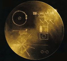 "This is the record aboard the Voyager. It features an image of a hydrogen atom, and a ""map"" giving our location in our solar system. The record plays music and messages from all over the world."
