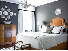Google Image Result for http://campbelldesignsllc.files.wordpress.com/2010/05/gray-and-orange-bedroom.jpg