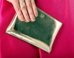 This gold dot clutch works perfectly with Catherine' s bright party dress. It's by Kate Spade and was $15 at a sample sale. (Allison Carey/The Plain Dealer)