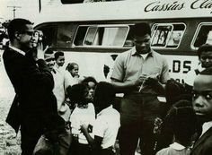 Brother Malcolm taking pictures of Cassius Clay (Muhammad Ali) as he signs autographs for some kids. Brother Malcolm always had a camera, his hobby was photography. Malcolm X, Betty Shabazz, Float Like A Butterfly, Human Rights Activists, Black Panther Party, Fear Of Flying, Muhammad Ali, African American History, My People