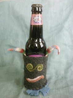 Such a cute and fun gift! Can or Bottle Cozy by CozyMonsters on Etsy, $16.00