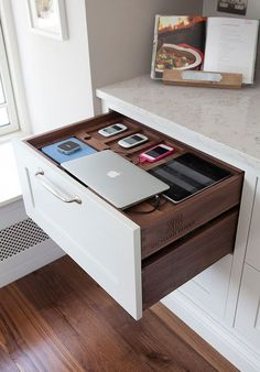 pacious charging station in the kitchen can power up everything from your laptop to iPad [From: Richard Burke Design] - Welcome My Decor Smart Kitchen, Kitchen Logo, Home Office Storage, Home Organization, Kitchen Drawers, Kitchen Storage, Kitchen Cabinets, Home Decor Kitchen, Home Kitchens