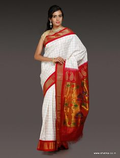 This Saraswathi white Paithani Silk Saree blends the beautiful white with radiating red with mild and delicate zari work in check pattern. This paithani silk saree presents the youthful and smart paithani saree patterns in a neat finish. This silk saree is yet another must have all time drape