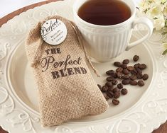 """The """"Perfect Blend"""" Burlap Bag with 1.5 oz of Coffee (Set of 12) Now this is a favor bag if there ever was one! Big, burlap, branded and carrying coffee to remind everyone at your down-home wedding that the two of you are the perfect blend. Pure, heartwarming country charm! - See more at: http://favorcouture.theaspenshops.com/The-Perfect-Blend-Burlap-Bag-with-Coffee.html#sthash.9rcFtBBF.dpuf"""