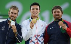 ARCHERY - INDIVIDUAL MEN - Gold medallist Bonchan Ku (C) of South Korea, Silver medallist Jean-Charles Valladont (L) of France and Bronze medallist Brady Ellison